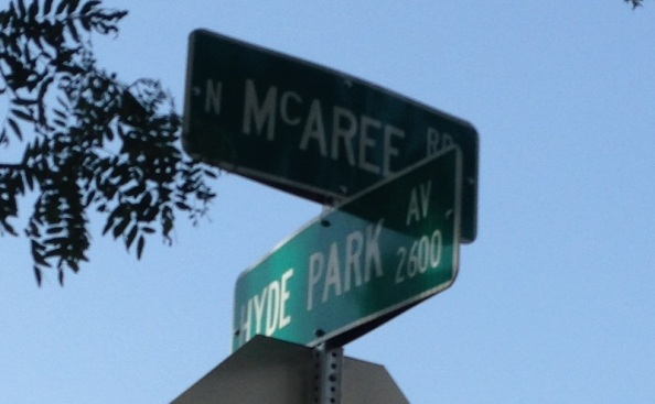 A crossroads sign at McAree Rd. and Hyde Park Ave.